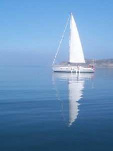 single sailboat w reflection